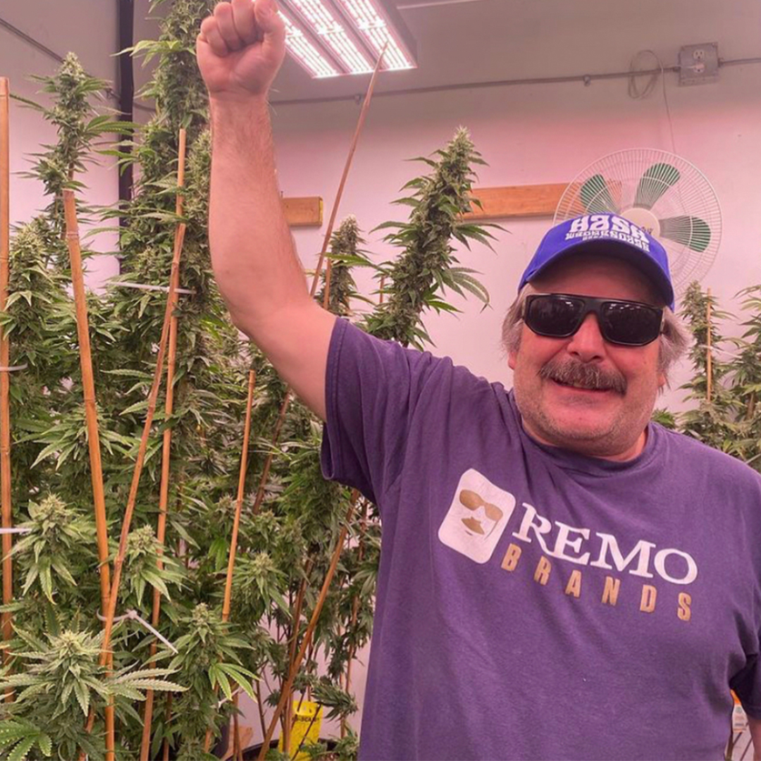 urban remo putting his arm next to his buds