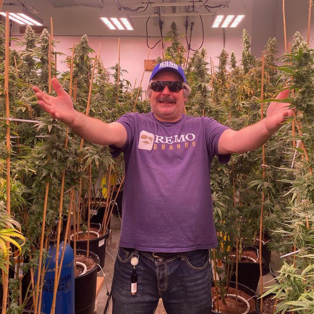 urban remo standing in front of medical plants